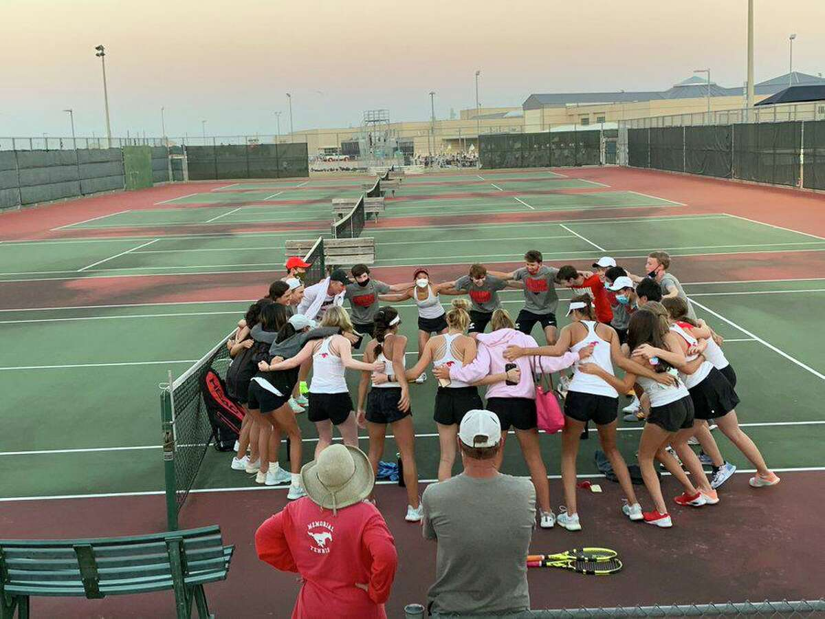 The Memorial tennis team celebrates its 10-2 victory in the Region III-6A championship match against Tompkins, Nov. 11 at Tompkins High School. The Mustangs will play in their 12th consecutive state tournament.