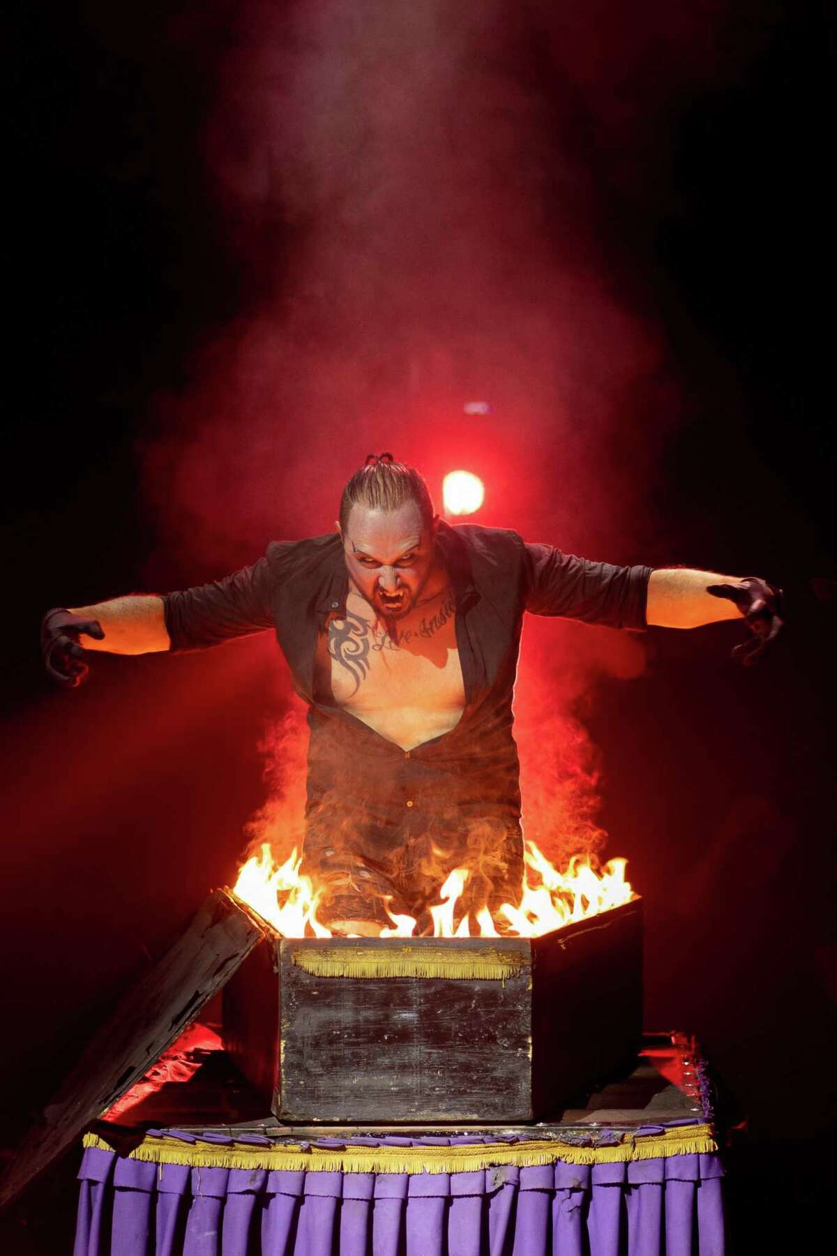 James Giroldini works the Fire Coffin in Paranormal Cirque, which comes to Ford Park on Nov. 12, 2020.