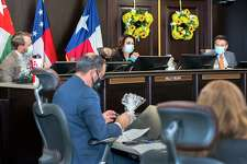 Laredo City Council members George Altgelt, Nelly Vielma and Mayor Pete Saenz are pictured with City Manager Robert Eads in the foreground during a council meetings on Sept. 8 at City Hall.