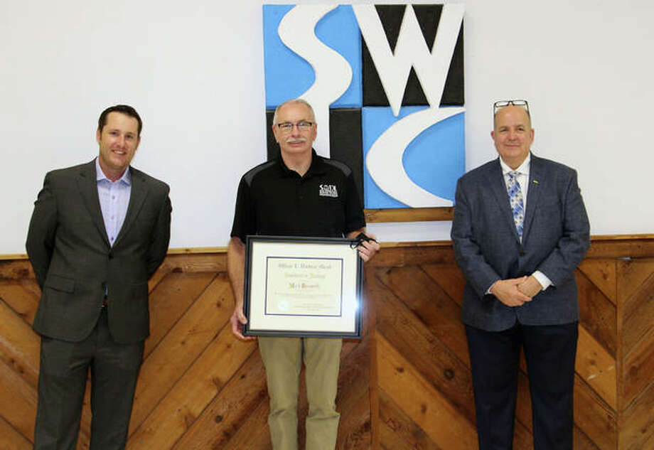 From left, NTMA St. Louis Chapter President Tony Maus is shown with Mark Bosworth, Southwestern Illinois College Industrial Technology Coordinator, and NTMA President Roger Atkins. Bosworth received the William E. Hardman Award for Excellence in Training on Nov. 10.