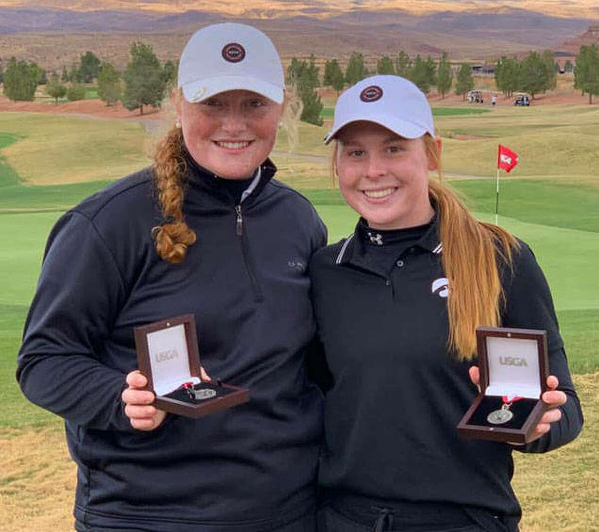 Marquette Catholic junior Gracie Piar (left) and Edwardsville junior Riley Lewis show off their championship medals from the 2021 U.S. Women's Amateur Four-Ball Qualifying golf tourney Monday at SunRiver Golf Club in St. George, Utah.
