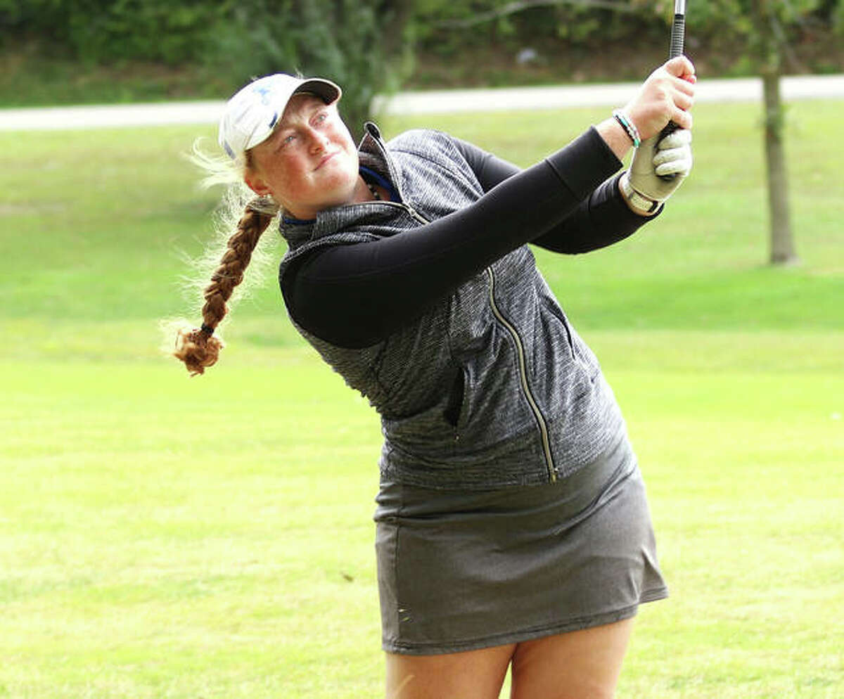 Marquette's Gracie Piar watches her shot on the second hole at Oak Brook golf course during the Gair Bair Invite on Oct. 1 in Edwardsville. Piar won the tourney with a 73.