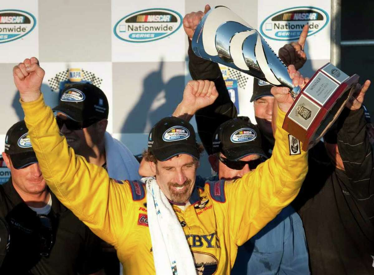 Boris Said celebrates his victory in the NASCAR Nationwide Series auto race Sunday, Aug. 29, 2010, in Montreal. (AP Photo/The Canadian Press, Paul Chiasson)