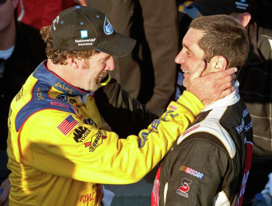 Winner Boris Said, left, is congratulated by second-place finisher Max Papis, of Italy, for his victory during the NASCAR Nationwide Series auto race Sunday, Aug. 29, 2010, in Montreal. (AP Photo/The Canadian Press, Paul Chiasson) Photo: Paul Chiasson, AP / The Canadian Press
