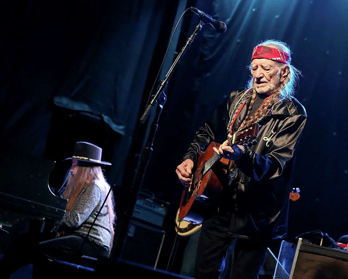 Willie Nelson (R) and Bobbie Nelson perform in concert during the Luck Reunion at Luck, Texas on March 16, 2017 in Spicewood, Texas.