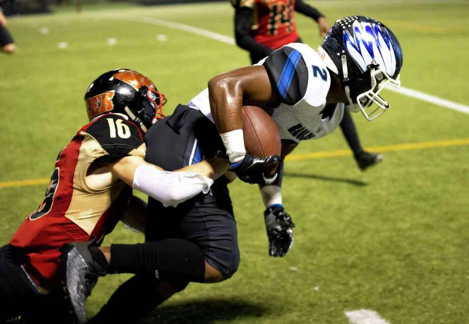 New Caney wide receiver Billy Williams Jr. (2) is pushed toward out of bounds by Caney Creek defensive back Rowdy Sebastian (16) during the second quarter of a District 8-5A (Div. I) football game at Moorhead Stadium in Conroe. Photo: Gustavo Huerta, Houston Chronicle / Staff Photographer / 2020 © Houston Chronicle