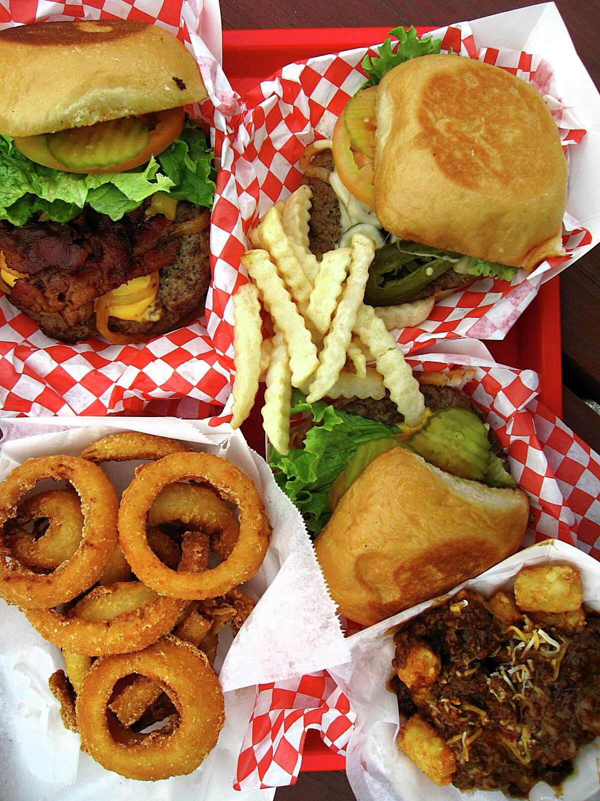 Burgers and sides at Papa's Burgers include onion rings, the triple-meat Jack Burton Burger, El Caliente Burger with jalapenos and pepperjck cheese, crinkle-cut fries, a basic Papa's Cheeseburger and chili-cheese tater tots.