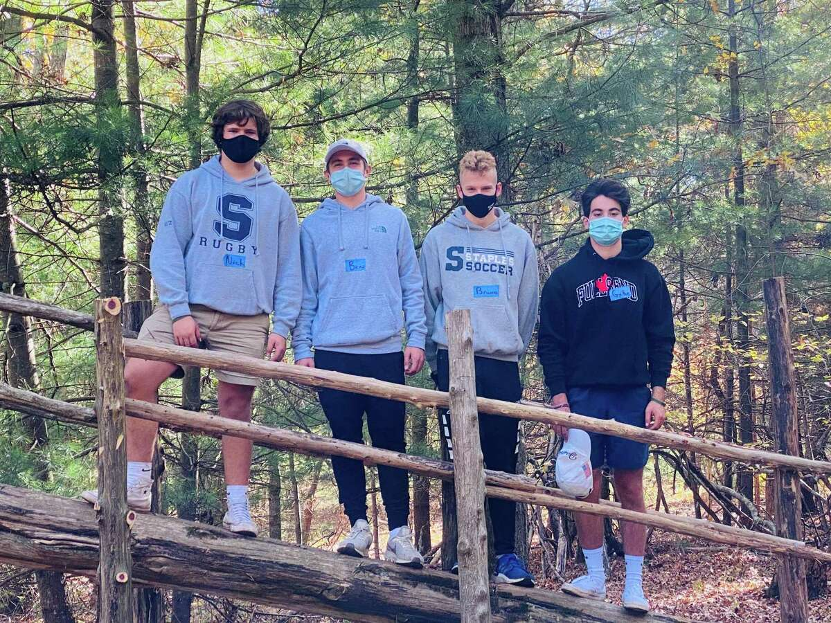 SLOB (Service League of Boys) crew Nick Seitz, Ben Berkley, Bruno Guiduli, and Gabe Maiolo on the Tower they helped repair.