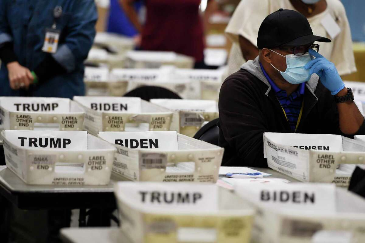 Cobb County Election official sort ballots during an audit, Friday, Nov. 13, 2020, in Marietta, Ga. The state is doing a complete recount.