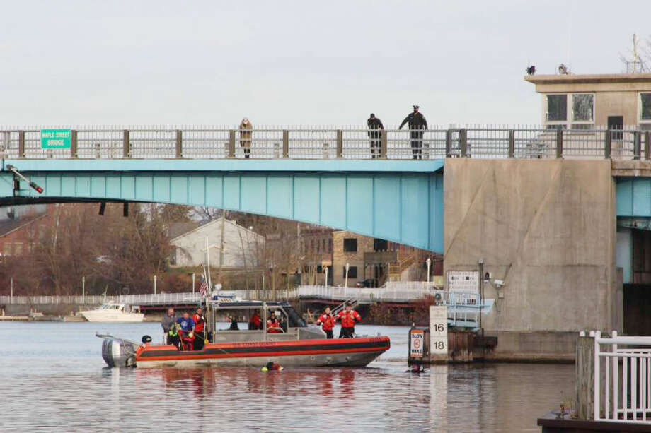 First responders from a list of departments such as the Manistee County Sheriff's Office as well as a dive team and the U.S. Coast Guard could be seen along the Manistee River channel and downtown Manistee Thursday afternoon. Photo: Michelle Graves/News Advocate