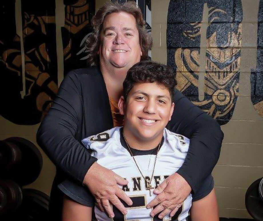 Bullock Creek senior lineman Obie Mathis is pictured here with his mother Lori, who passed away recently from cancer, in an undated photo. Photo: Photo Provided