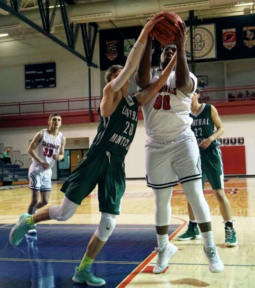 D.J. GreenBay, of Big Rapids, fights for control of a rebound during a game last season against Central Montcalm. (Pioneer file photo)