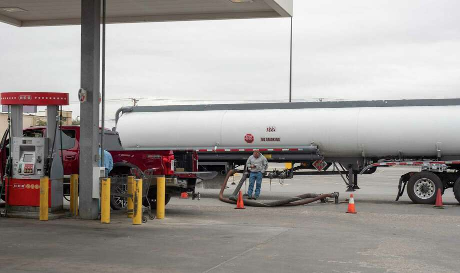 A gasoline tanker fills the underground tanks Friday at H-E-B on West Wadley Avenue. The average price of gasoline jumped in West Texas after the price of oil increased. Photo: Tim Fischer, Midland Reporter-Telegram