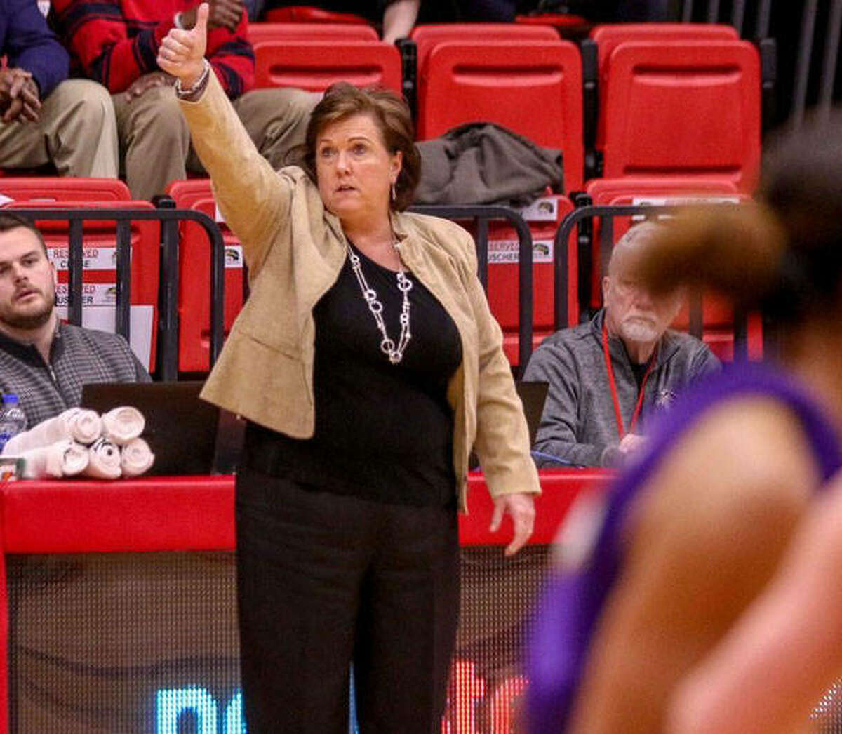 SIUE women's basketball coach Paula Buscher signals a play into her team during a game last season.