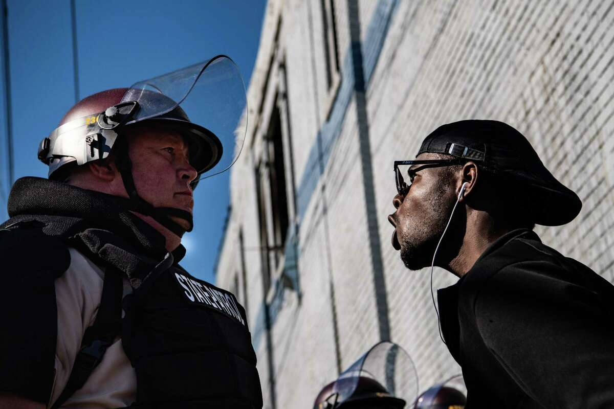 A protester screams at a Minnesota State Patrol officer on May 29 in Minneapolis.
