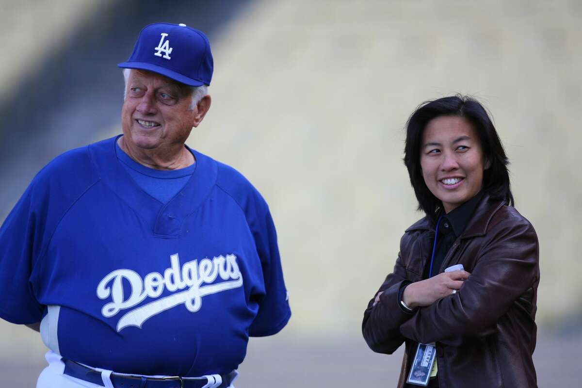 Former Dodgers Manager Tommy Lasorda talks with Assistant General Manager Kim Ng of the Los Angeles Dodgers, before game against the Boston Red Sox at Dodger Stadium in Los Angeles, CA. (Photo by Larry Goren/Icon SMI/Icon Sport Media via Getty Images)
