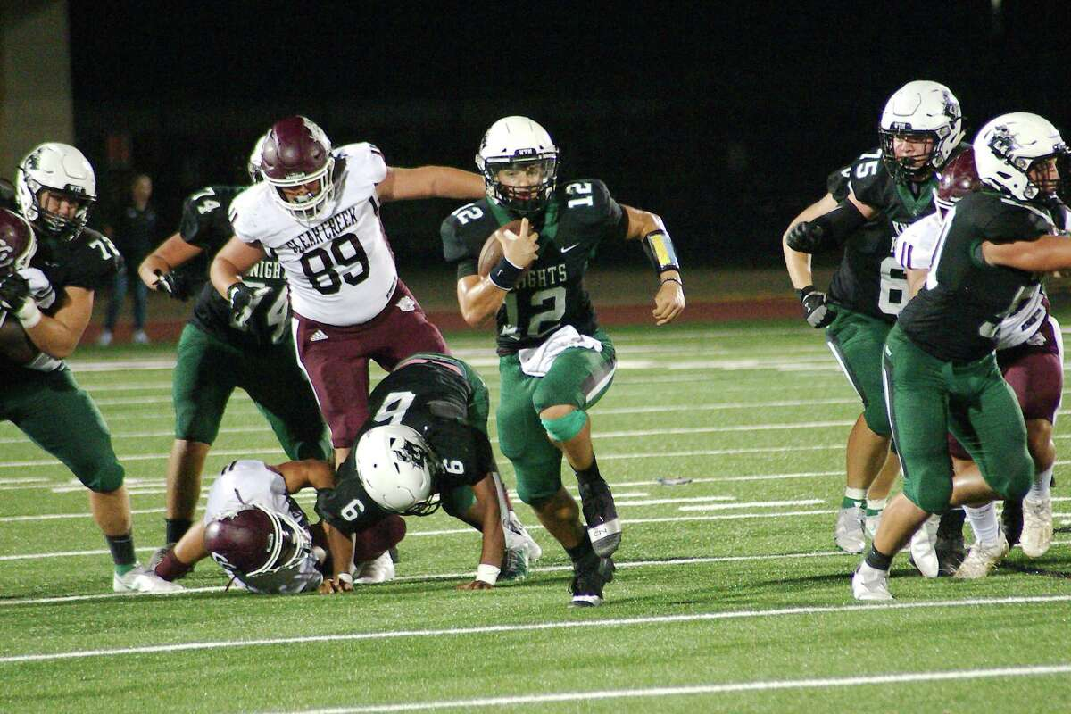 Clear Falls' Pierson Morelli (12) scrambles for yardage.