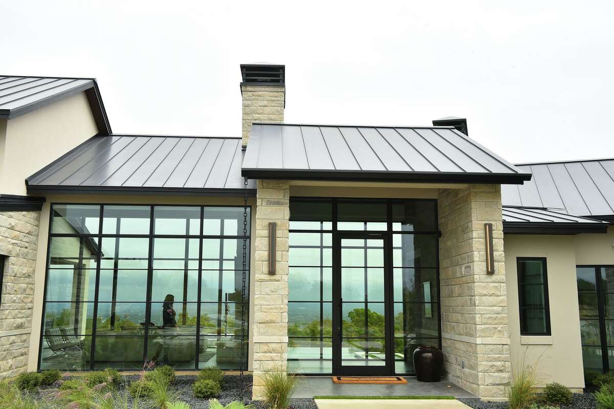 Large windows in front and back of the Cordillera Ranch home give visitors a see-through glimpse of the view off in the distance.