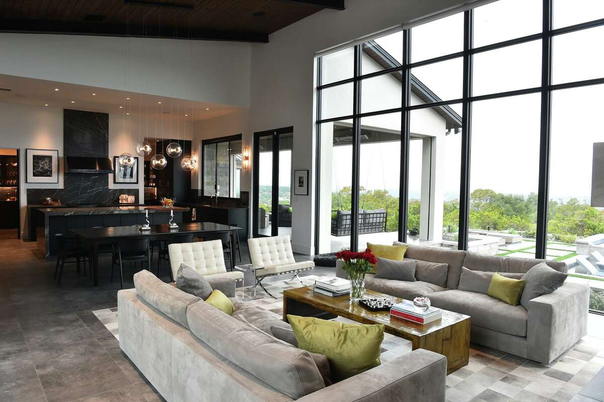 The main living area, which includes a living room, dining room and kitchen is one large open space with plenty of windows, a drop down in the ceiling where the kitchen and dining room meet the only visual divider between the two.