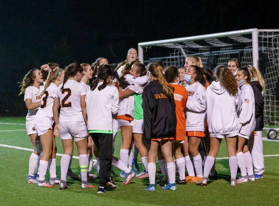 The Ridgefield girls soccer team celebrates its win over Wilton in the FCIAC Central semifinals. Photo: Gretchen McMahon / For Hearst Connecticut Media