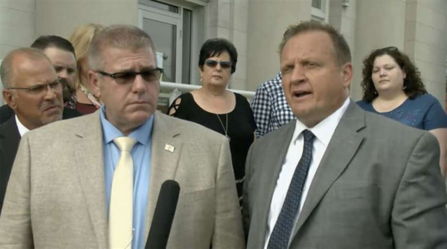 Rep. Darren Bailey (left), R-Xenia, and his attorney, Thomas DeVore, speak to reporters July 2 outside the Clay County Courthouse in Louisville. Their case has been moved to Sangamon County, where a judge is considering a motion from the state to dismiss the case and others like it. Photo: Blueroomstream.com