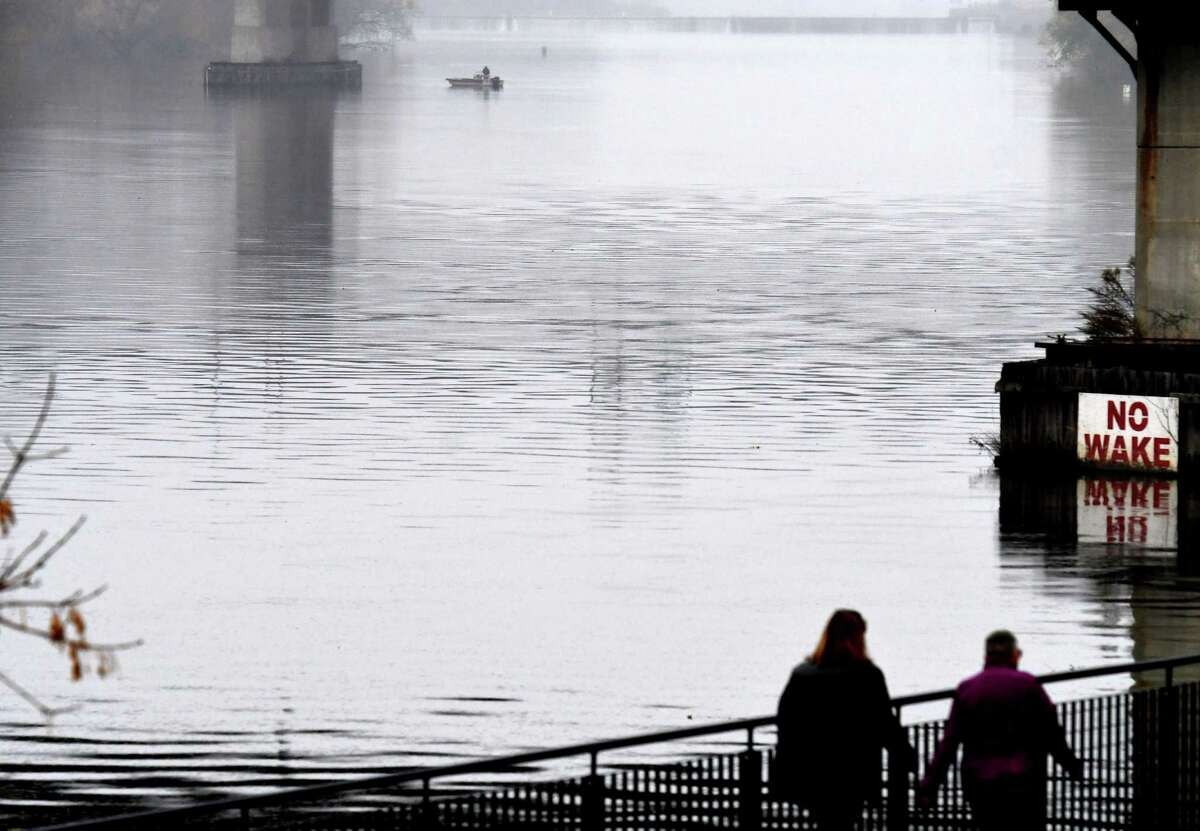 Under misting overcast conditions, a solitary angler works the Hudson River below Federal Lock on Friday, Nov. 13, 2020,13, 2020, in Troy, N.Y. (Will Waldron/Times Union)