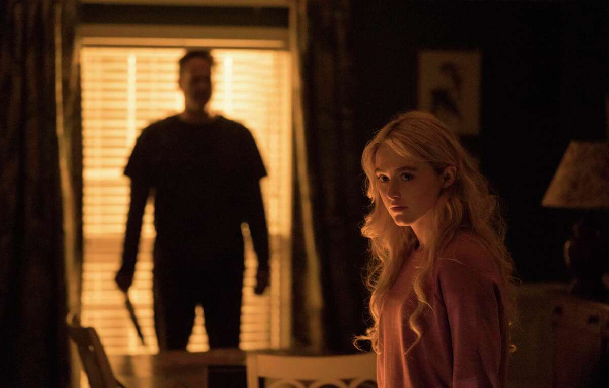 """This image released by Universal Pictures shows Kathryn Newton and Vince Vaughn, left, in a scene from """"Freaky."""" (Brian Douglas/Universal Pictures via AP)"""