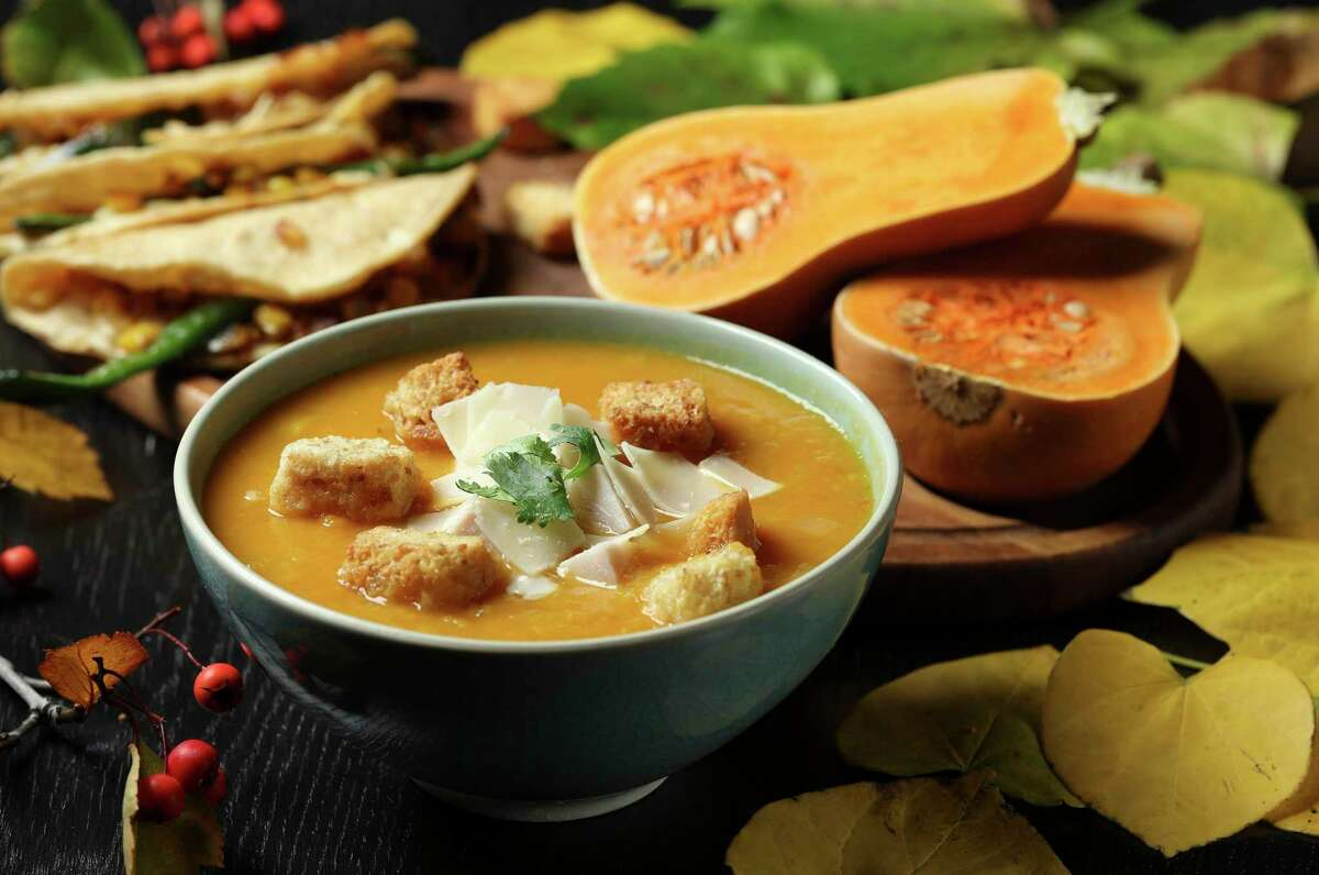 The squash and leek soup is bolstered by other aromatics, garlic and onion, along with a hit of heat from red chile. Serve cheesy quesadillas on the side for a fantastic fall dinner. (Abel Uribe/TNS)