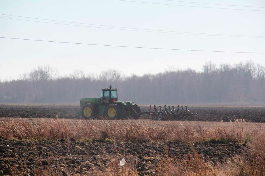 A tractor works in fields north of Kinde. Farmers across Huron County are finishing up their harvest for the season, with the coronavirus pandemic affecting them in different ways. (Robert Creenan/Huron Daily Tribune)
