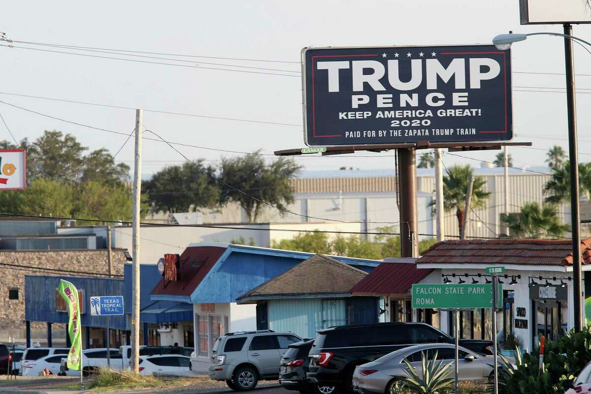 A Trump/Pence billboard greets drivers along U.S. 83 in Zapata, Texas, Wednesday, Nov. 11, 2020. President Donald Trump was able to carry the traditional Democratic stronghold by over 5 percentage points over Joe Biden.