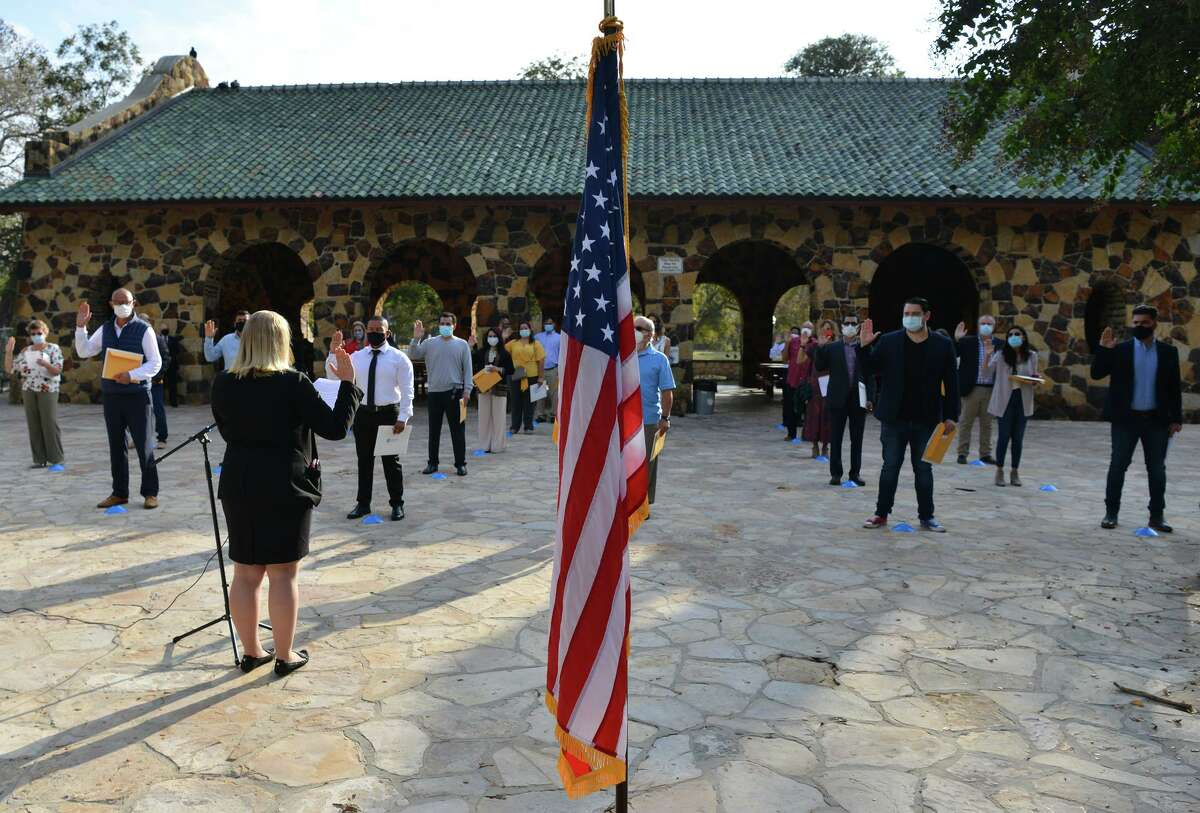Tina Dodd of U.S. Citizenship and Immigration Services administers the oath of citizenship during a naturalization ceremony Friday morning at the Joske Pavilion in Brackenridge Park. The 240 citizenship candidates originate from 60 countries as diverse as Australia, Brazil, Cameroon, Cuba, Egypt, Italy, Mexico, Romania and Zambia.