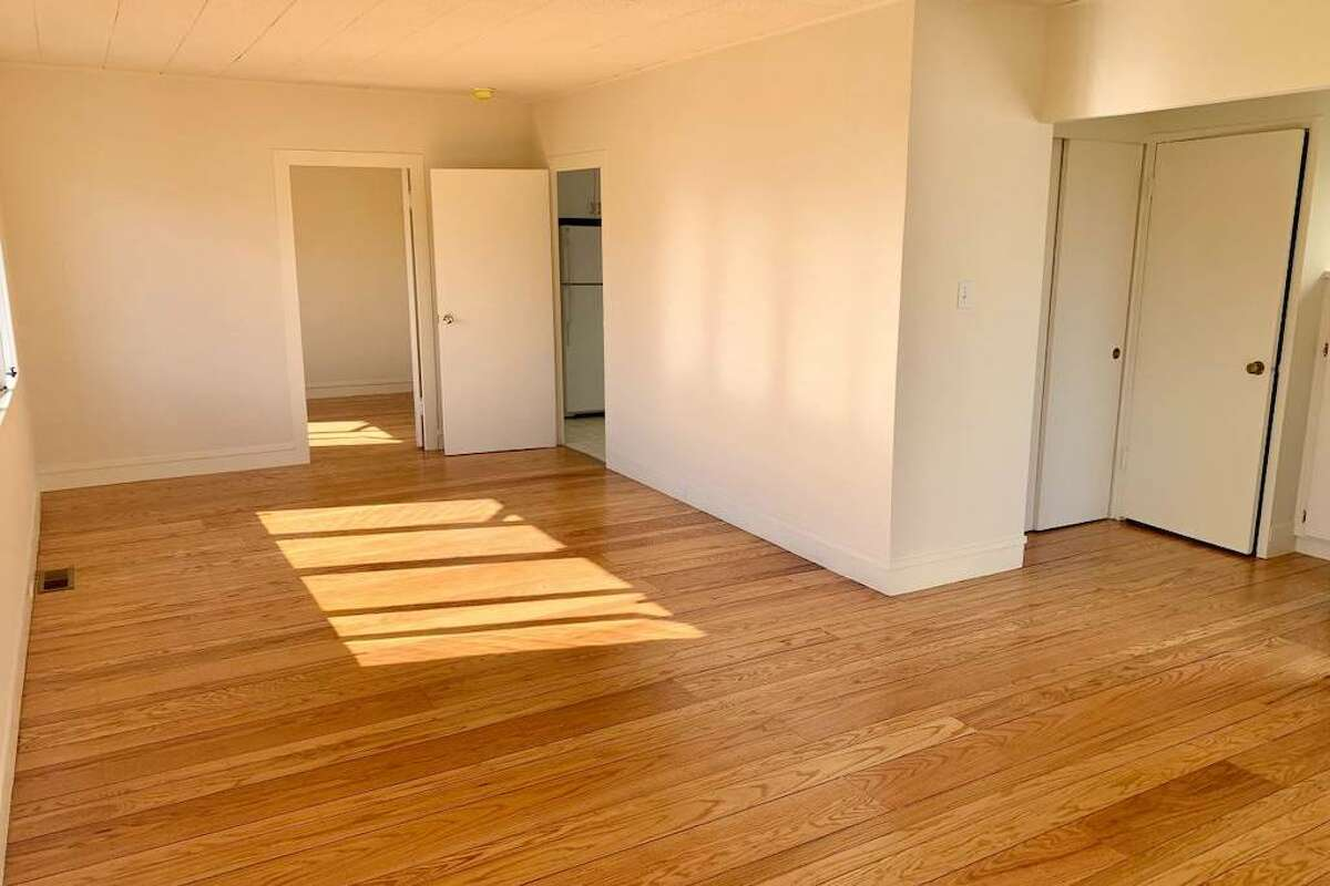 The listing also says the unit was newly painted and has refurbished hardwood flooring throughout.