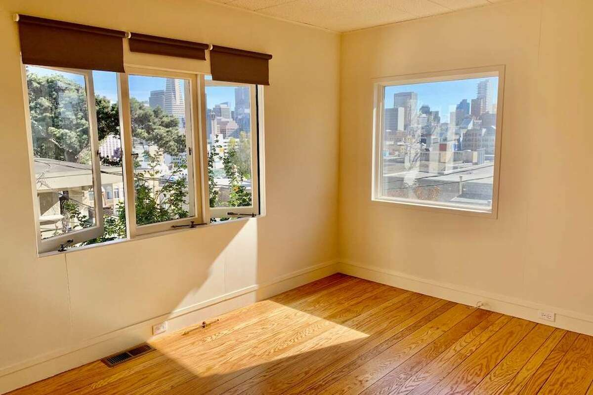 There are extensive views of the city skyline from the living room.