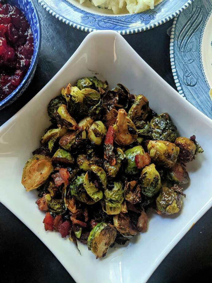 Brussels sprouts roasted with bacon and dried cranberries are easy to make, and full of fall flavor on Thanksgiving. (Gretchen McKay/TNS) / Pittsburgh Post-Gazette