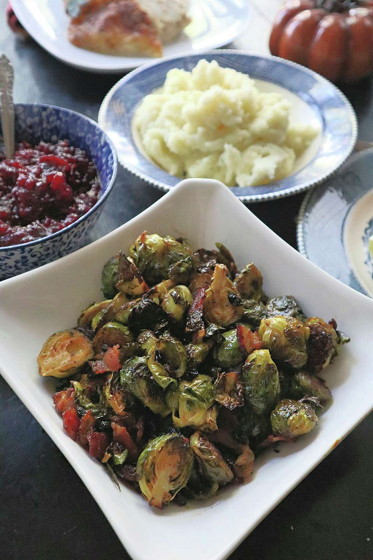 Brussels sprouts roasted with bacon and dried cranberries are easy to make, and full of fall flavor on Thanksgiving. (Gretchen McKay/TNS)