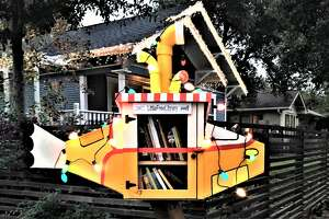 Katheryne Ellison's Little Free Library looks like a yellow submarine.