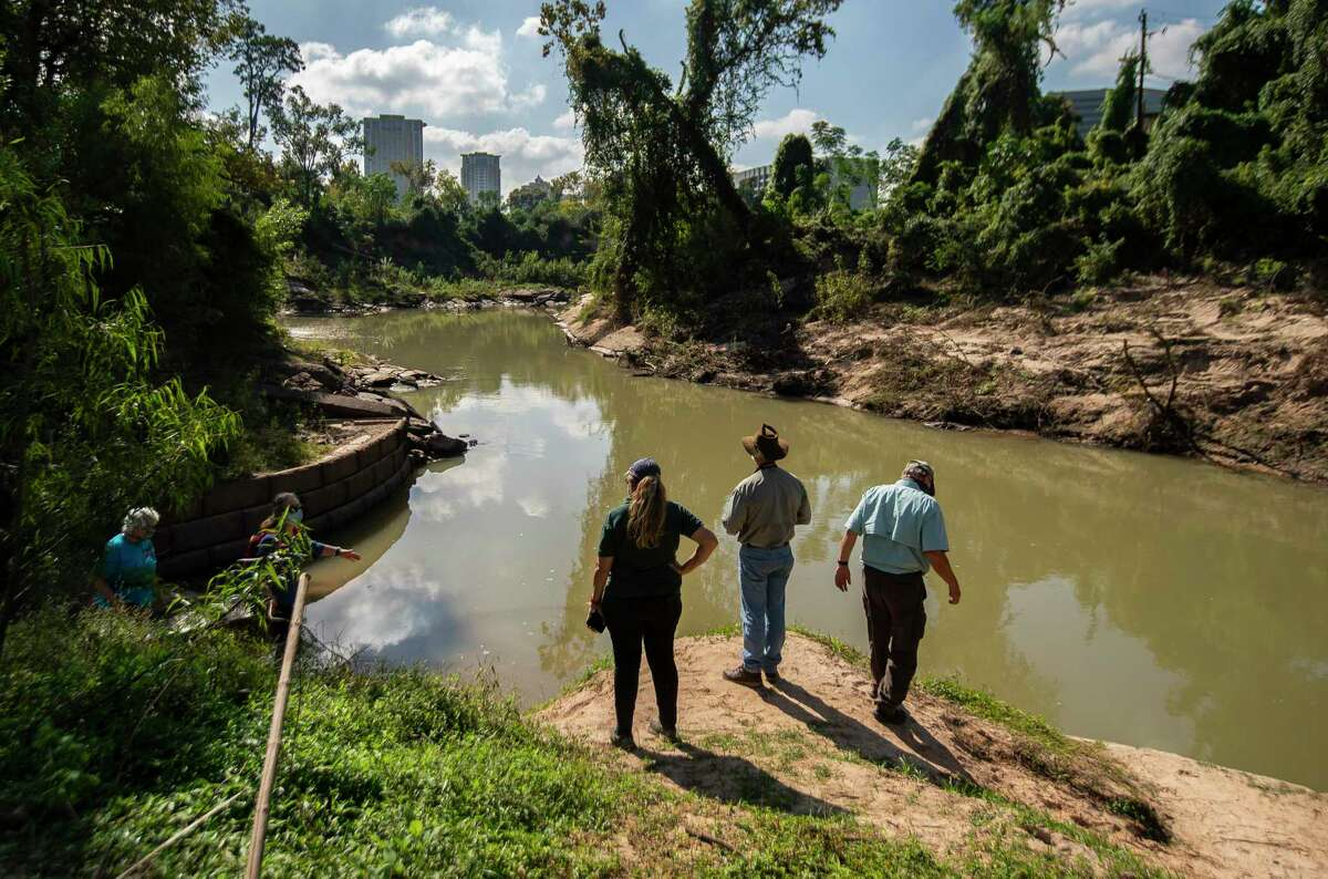 Conservationists inspect a point on Buffalo Bayou near Loop 610 West where erosion is pushing sediment downstream.