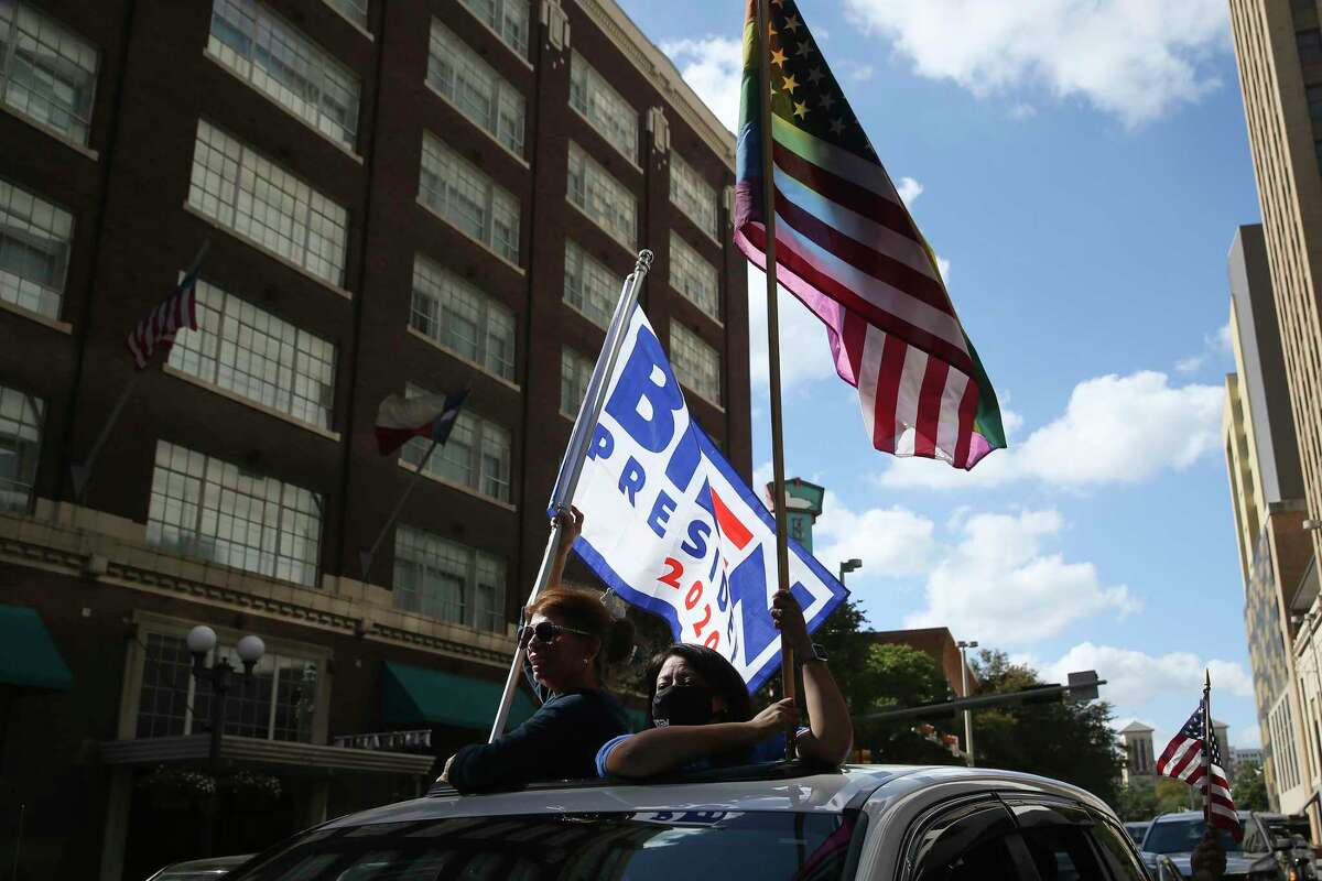 Supporters parade down Market Street Nov. 7 in celebration of President-elect Joe Biden's victory. Our readers are split on the outcome.