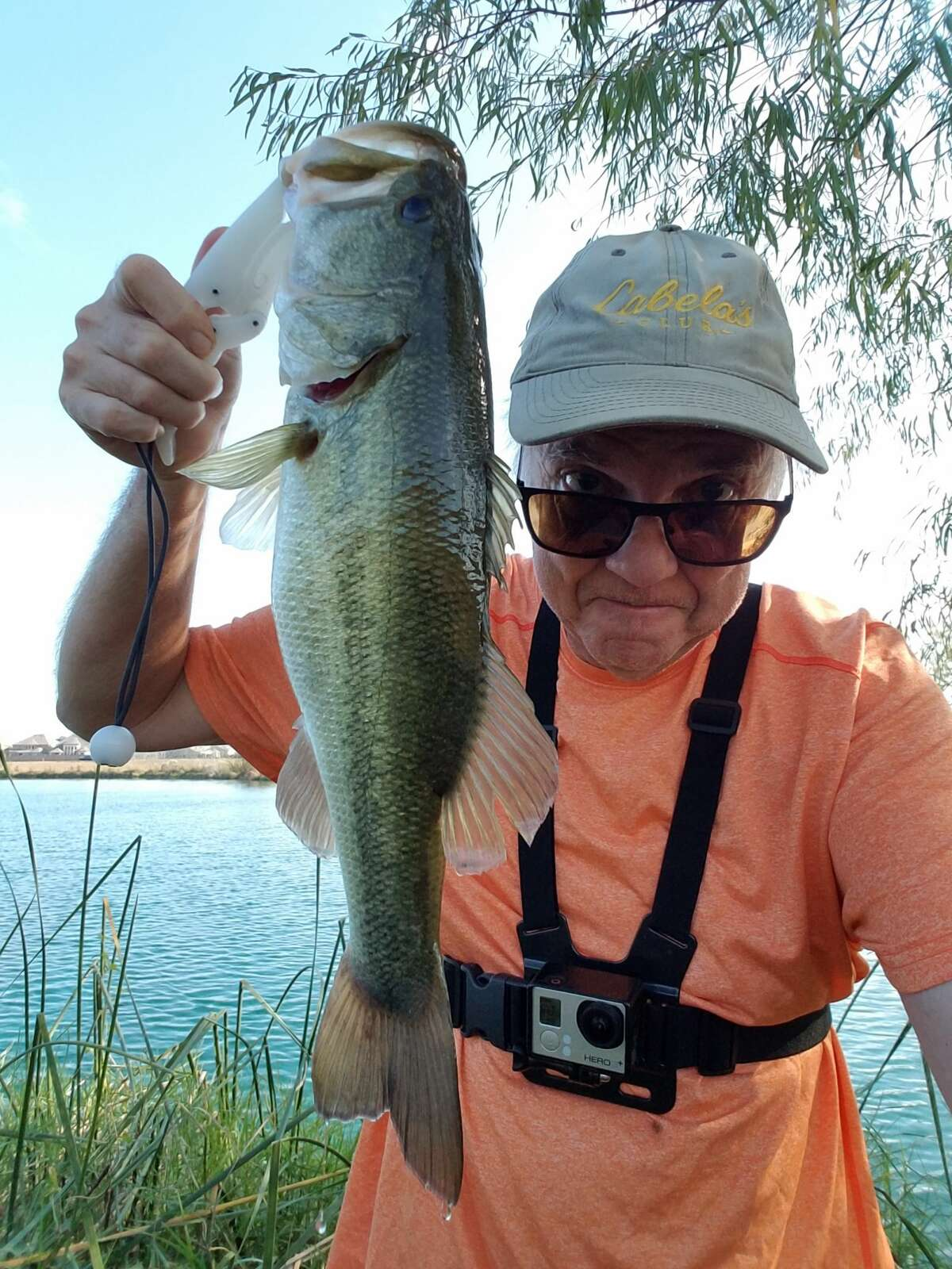 Chronicle photographer Kirk Sides shows off a recent catch at Edgewater lake in Webster