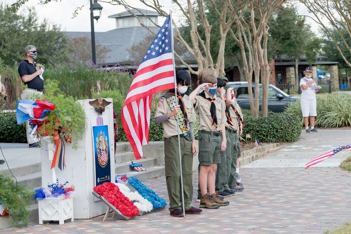 Boy Scout Troops 156 and 329 posted the colors for the Veterans Day Celebration in Bridgeland on Sunday, Nov. 8, 2020.