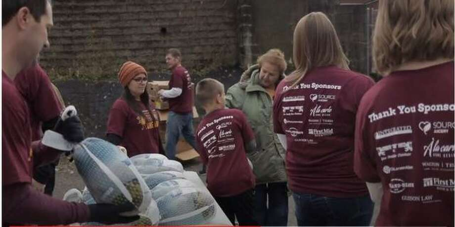 Volunteers help with the TorHoerman Law Turkey Giveaway in 2019 when 500 turkeys were handed out. This year's event is planned Nov. 21.