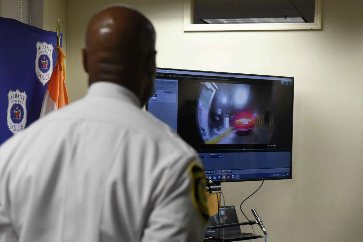 Albany Police Chief Eric Hawkins views body camera footage of officer David W. Haupt on Friday, Nov. 13, 2020, during a press conference at police headquarters in Albany, N.Y. Haupt, who joined the force in 2016, was suspended for 30 days on Wednesday while the department investigates body camera footage where Haupt is heard making racists remarks. (Will Waldron/Times Union)