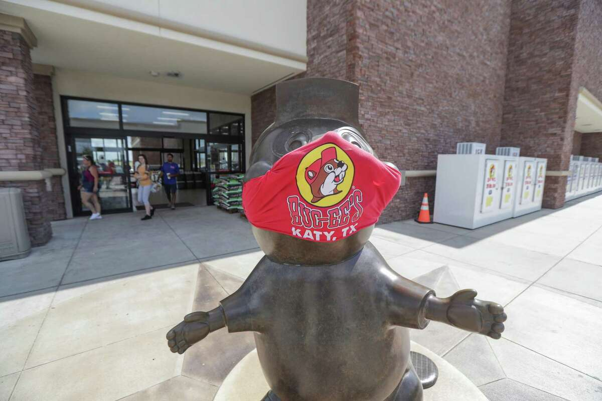 A masked Buc-ee's outside the store is a friendly reminder to wear a mask and practice social distancing Friday, June 19, 2020, in Katy.