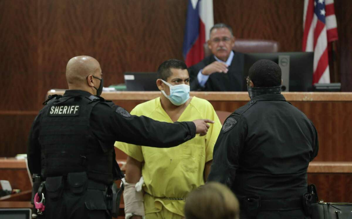 Elmer Manzano is escorted into Court 228 before Judge Frank Aguilar. He is charged in the death of Sgt. Harold Preston Wednesday, Oct. 28, 2020, in Houston.