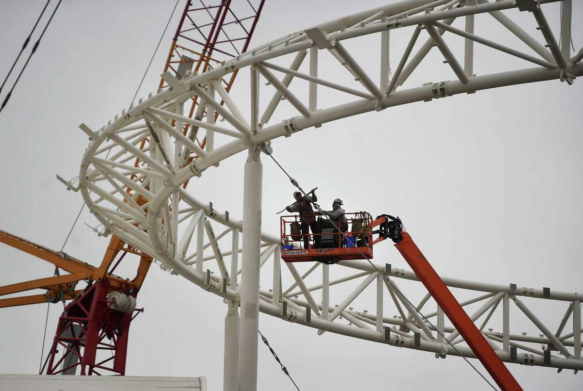 Workers tighten cables on the superstructure of the Harbor Yard Amphitheater in Bridgeport, Conn. on Monday, October 26, 2020.