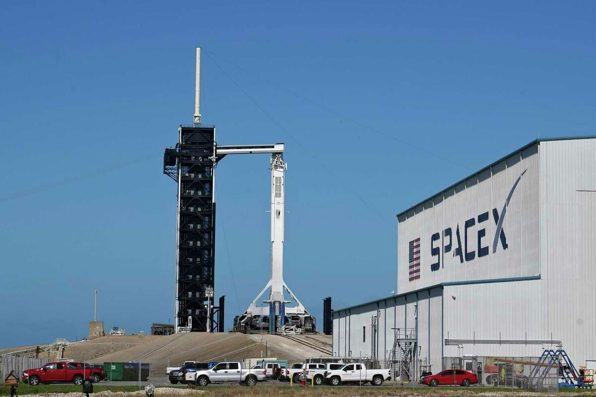 A SpaceX Falcon 9 rocket, with the company's Crew Dragon capsule attached, sits on the launch pad at Launch Complex 39A Friday, Nov. 13, 2020, at the Kennedy Space Center in Cape Canaveral, Fla.