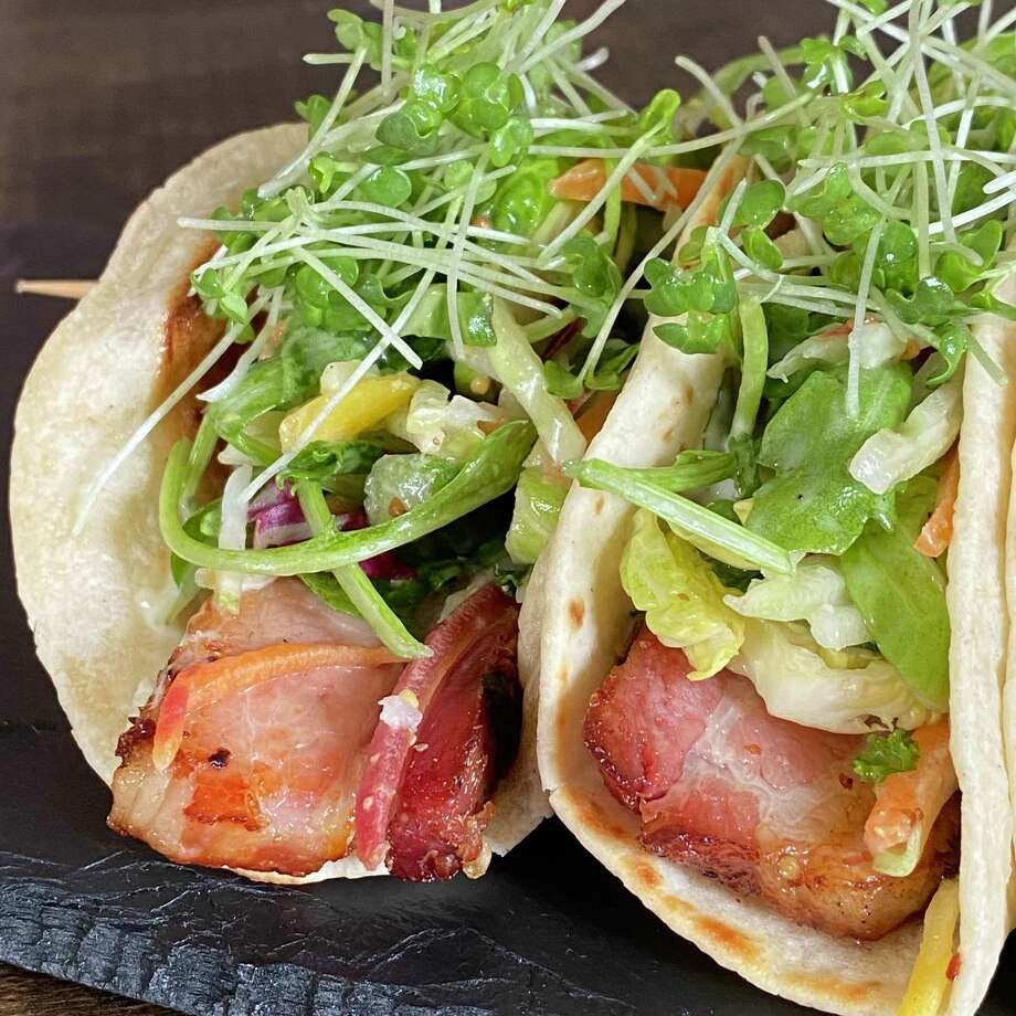 Braised Bacon Tacos are one of the small and share plate items from 1754 House's menu. Photo: Michael Bates-Walsh / Contributed Photo