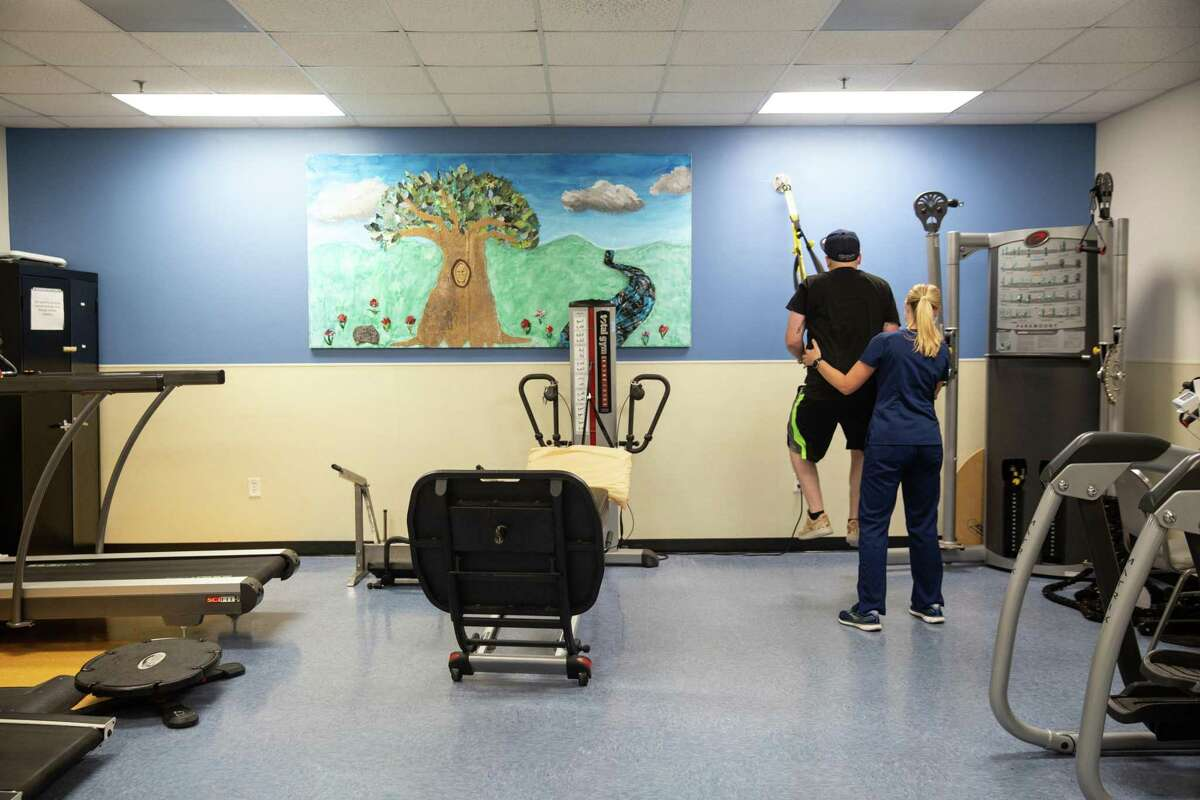 Jonathan Bomar, 31, works with TRX bands to improve his jumping power during physical therapy at TIRR Memorial Hermann Outpatient Rehabilitation - Kirby Glen on Oct. 13, 2020.