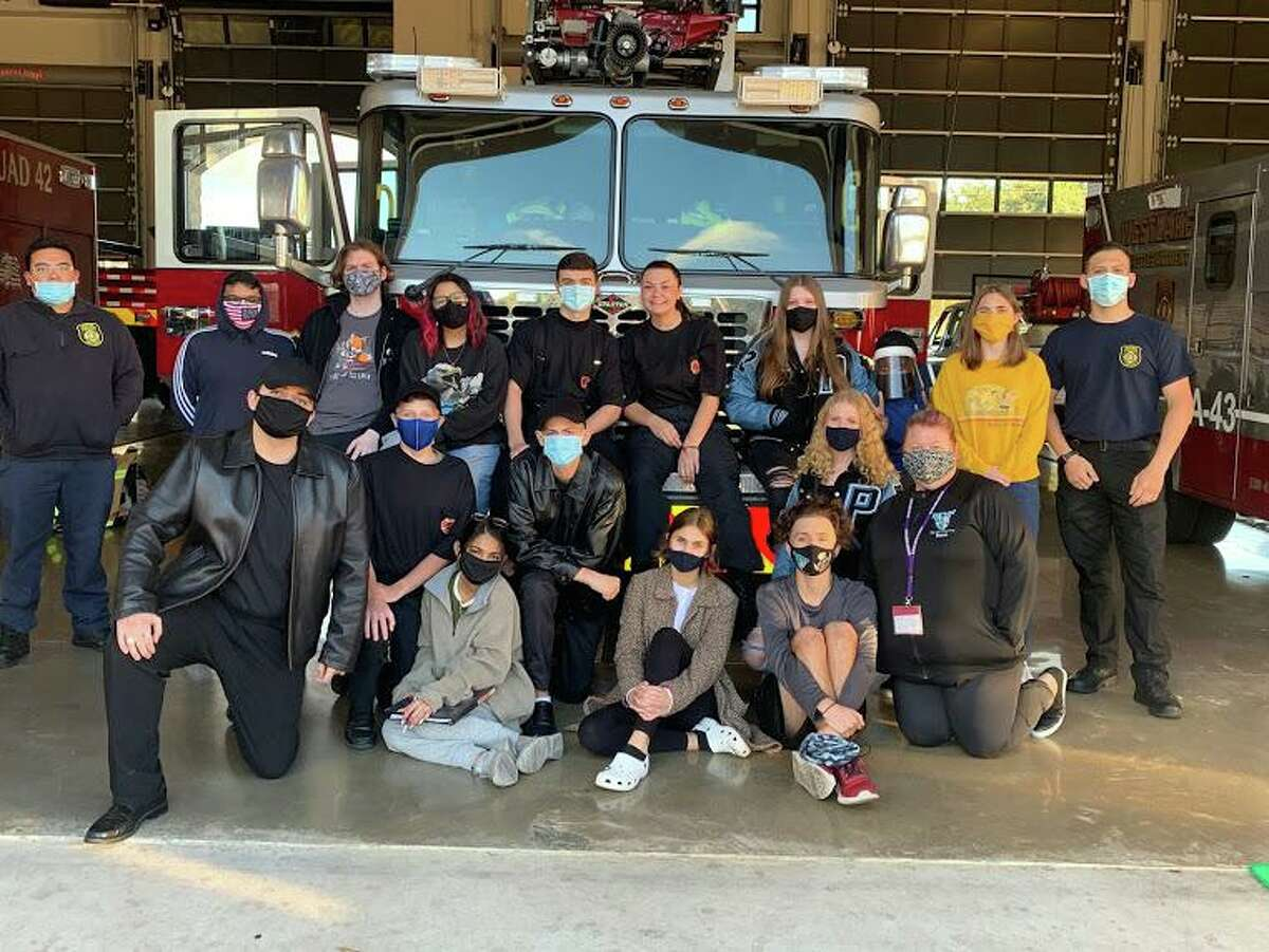 Paetow High School theater students pose at the Westlake Fire Department in Katy while filming their production of Fahrenheit 451.