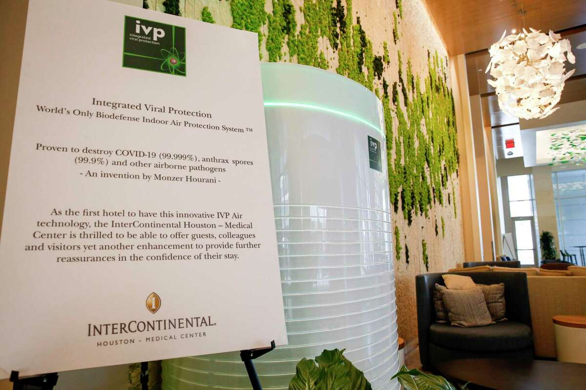 An IVP Air filtration unit filters air in a hotel lobby Monday, Sept. 28 2020, at the InterContinental Houston-Medical Center hotel in Houston.